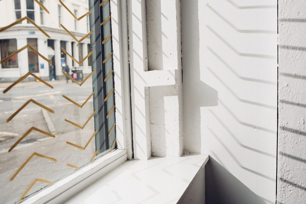 Mesa - brand pattern on window