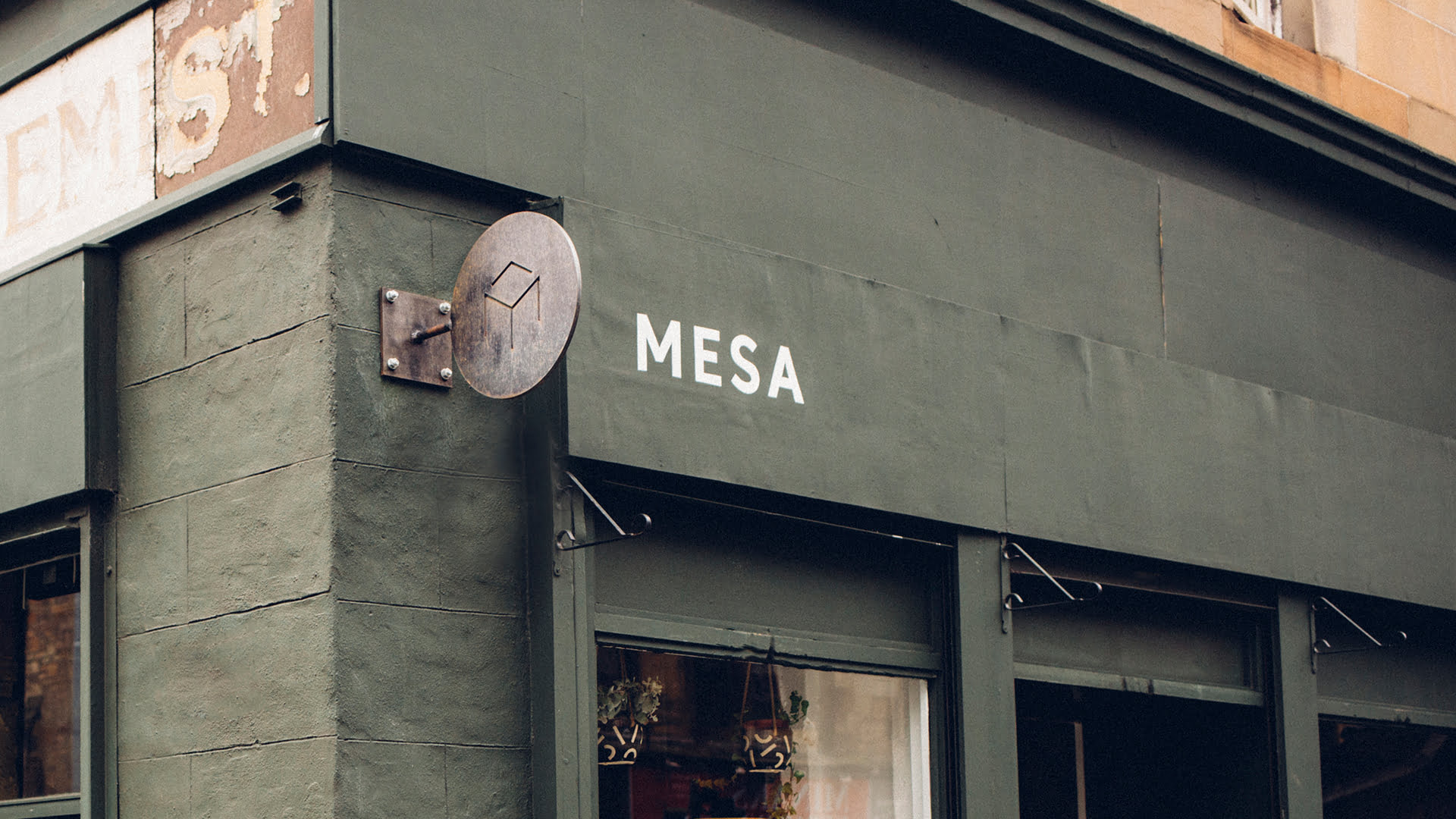 Mesa external signage - hand painted logo and cast iron table logo