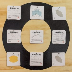 WEST - Interactive feedback wall with branded coasters featuring the 4 icons