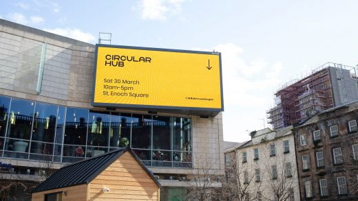 Circular hub big screen with campaign brand directing people to the hub